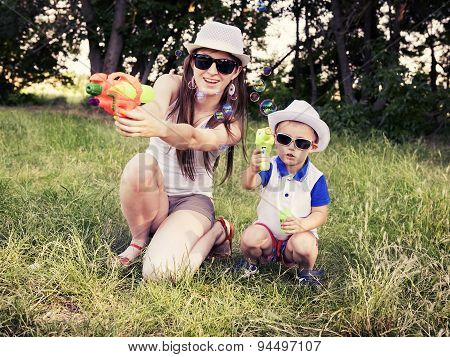 Mother Plays With Her Son Outdoors