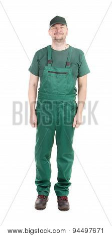 Worker in green overalls