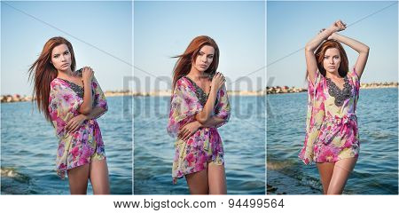 Young sexy red hair girl in multicolored blouse posing on the beach. Sensual attractive woman