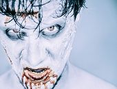 foto of horror  - Portrait of scary zombie man in blood Halloween or horror theme - JPG
