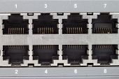 image of utp  - close up lan switch with 8 ports - JPG