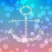 stock photo of starry  - Starry anchor decor on colored background with bokeh - JPG