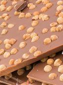 stock photo of hazelnut  - milk chocolate block with hazelnuts - JPG