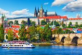 stock photo of old bridge  - Scenic summer panorama of the Old Town architecture with Vltava river Charles Bridge and St - JPG