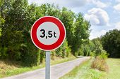 picture of restriction  - Traffic sign of 35 tons weigh restriction on a rural road background - JPG