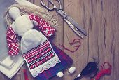 stock photo of rag-doll  - Belarusian traditional doll  production on a wooden background toning - JPG