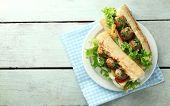 image of meatball  - Homemade Spicy Meatball Sub Sandwich on plate - JPG