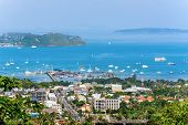 image of dock  - High angle view dock travel by boat at Ao Chalong bay and city sea side in Phuket Province Thailand - JPG