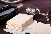 picture of matzah  - Matzo for Passover with metal tray and wine on table close up - JPG
