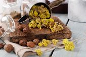 picture of roughage  - Dried herbs with nutmeg on table close up - JPG