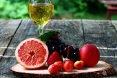 image of fruit platter  - A platter of seasonal fruits with a glass of juice - JPG