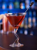 pic of cosmopolitan  - Cosmopolitan cocktail shot on a bar counter in a nightclub - JPG