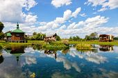 image of chapels  - Wooden Chapel on the water in Radecznica Poland - JPG
