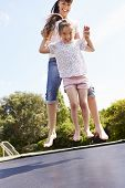 pic of bouncing  - Mother And Daughter Bouncing On Trampoline Together - JPG
