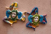 stock photo of triskelion  - Ceramic souvenirs triskelions from Sicily Italy - JPG