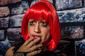 stock photo of prostitution  - Portrait of an afraid woman on the street crying on the wall during aggression - JPG