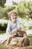 image of brother sister  - Brother And Sister Having Fun In Park - JPG
