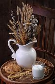 image of willow  - Light morning meal with milk and fresh bread and a bouquet from cones and a willow - JPG