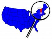 stock photo of united states map  - Vermont state outline set into a map of The United States of America below a magnifying glass - JPG