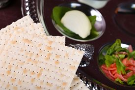 picture of seder  - Matzo for Passover with Seder meal on plate on table close up - JPG