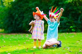foto of cowgirl  - Kids in cowboy and cowgirl costumes playing outdoors - JPG