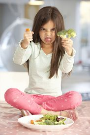 image of fussy  - Unhappy Young Girl Rejecting Plate Of Fresh Vegetables - JPG