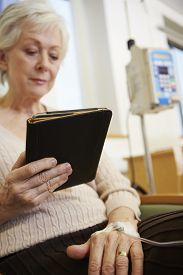 stock photo of chemotherapy  - Senior Woman Undergoing Chemotherapy With Digital Tablet - JPG