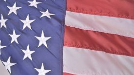 picture of emblem  - Patriotic holiday background of the american flag closeup faded for text overlay - JPG