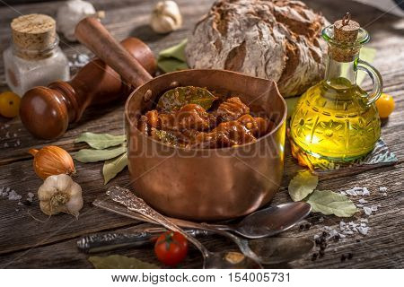 Homemade Goulash on rustic wooden background .