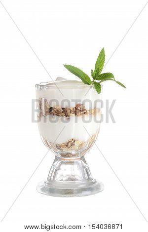 isolated vanilla parfait with granola and mint
