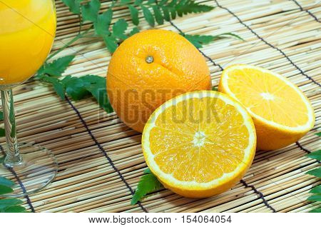 Sliced orange fruit segments - Stock Photo