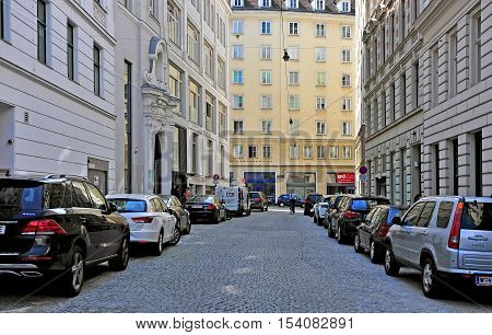 VIENNA AUSTRIA - JUNE 6: Cars parking in the street in downtown of Vienna on June 6 2016. Vienna is a capital and largest city of Austria.