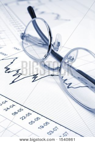 Stock Chart And Eyeglasses