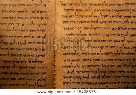 QUMRAN ISRAEL - JANUARY 10 2010: Dead Sea Scrolls on display at the caves of Qumran. They consist biblical and non-biblical manuscripts