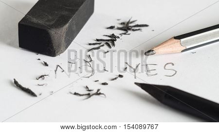 Mistake erase concept Change concept From no to yes Black pencil with black eraser on white background