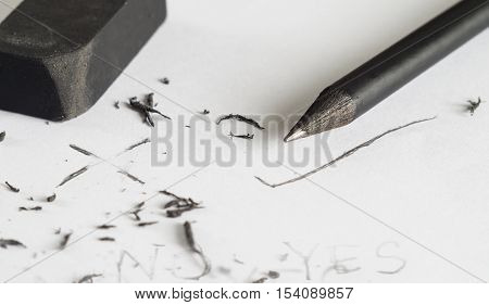 Mistake erase concept Change concept From wrong to cheap Black pencil with black eraser on white background