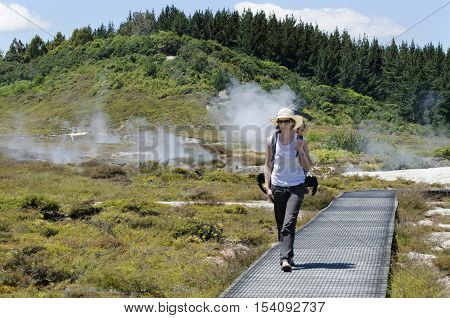 A woman traveler at the Craters of the Moon near Lake Taupo New Zealand.