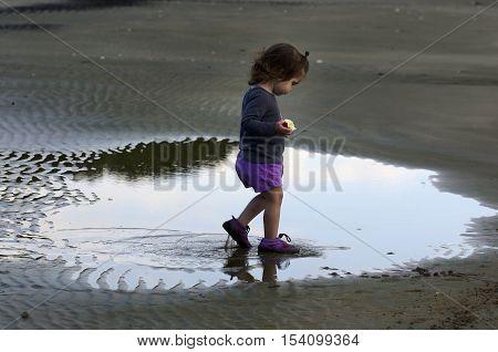 Childhood-baby-toddler-child-winter-rain-puddles-weather-beach