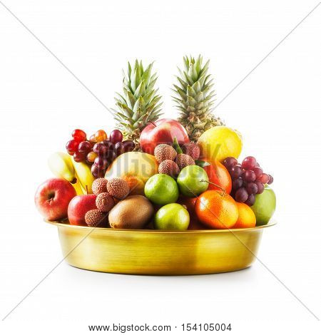 Fresh fruits in golden bowl. Healthy eating and dieting concept. Winter assortment. Single object on white background clipping path included