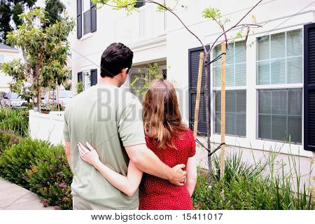 Young Couple In Front Of New Home
