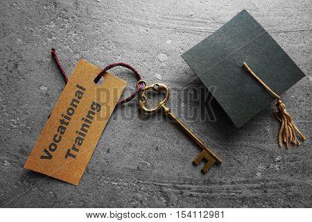 Vocational Training key tag with graduation cap
