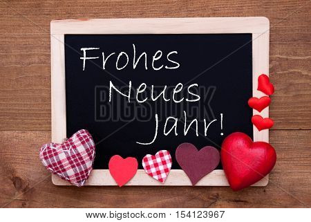 Blackboard With German Text Frohes Neues Jahr Means Happy New Year. Red Textile Hearts. Wooden Background With Vintage, Rustic Or Retro Style.