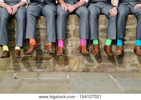 Funny colorful socks of groomsmen on wedding day