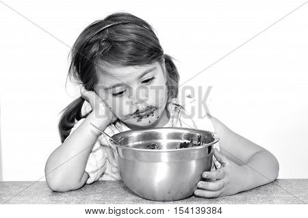 Little Girl Finished To Eat Big Bowl Of Chocolate Cream