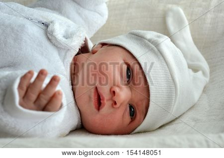 Newborn Baby With Warm Clothes