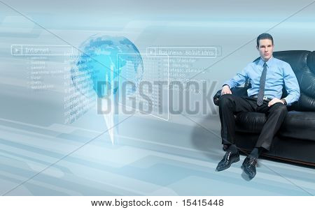 Young bossy businessman with holographic interface