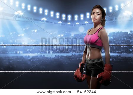Concentrated Asian Woman With Boxing Gloves