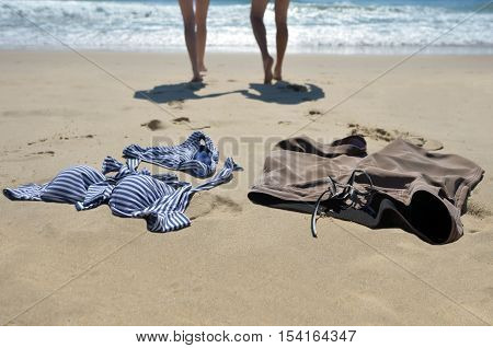 A couple swim naked in the sea, also known as streak or streaking