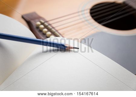 Pencil, Notebook and pencil on guitarWriting music