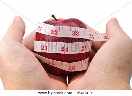 Hands Holding A Red Apple With Measuring Tape